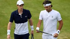 Murray marks return with doubles win