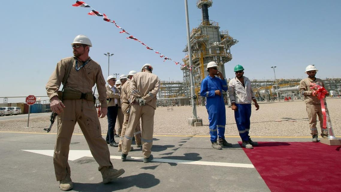 A member of security foreign personnel stays guard next to Exxon's foreign staff and Iraqi staff of the West Qurna-1 oilfield, which is operated by ExxonMobil on June 17, 2019. (Reuters)