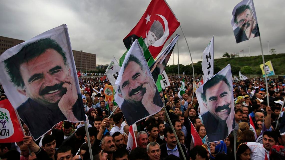 Supporters of the pro-Kurdish Peoples' Democratic Party, (HDP) wave a flag, centre, with Turkish Republic founder Mustafa Kemal Ataturk, and others of imprisoned Kurdish rebel leader Abdullah Ocalan, during a rally in Istanbul, Turkey, Monday, June 8, 2015. (AP)