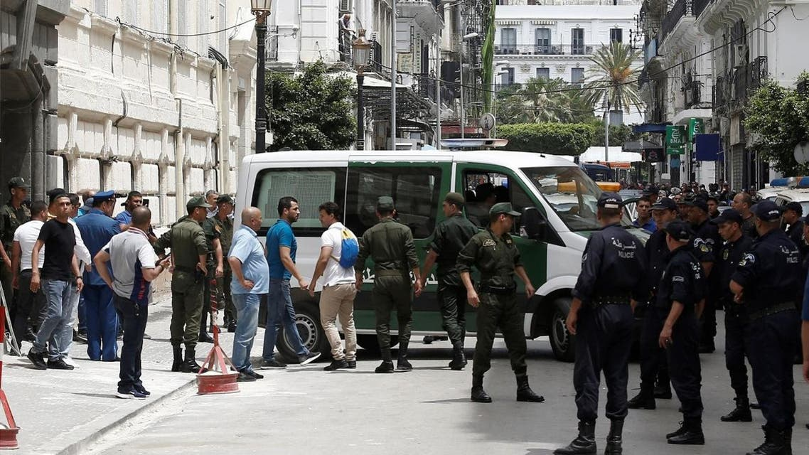 Police officers and members of national gendarmerie stand guard outside a court in Algiers, Algeria June 16, 2019. (Reuters)