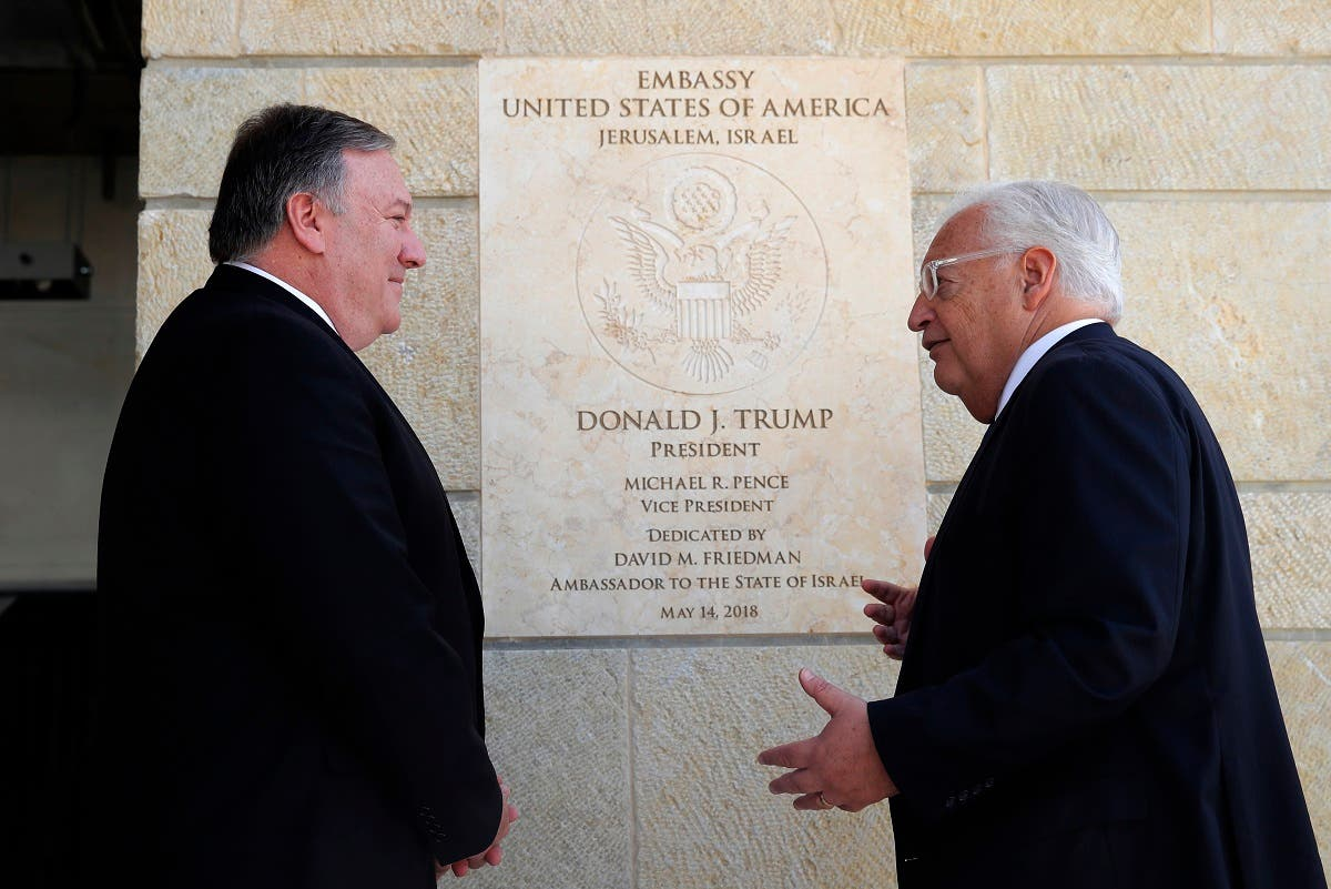 US Secretary of State Mike Pompeo and US ambassador to Israel David Friedman stand next to the dedication plaque at the US embassy in Jerusalem on March 21, 2019. (AFP)