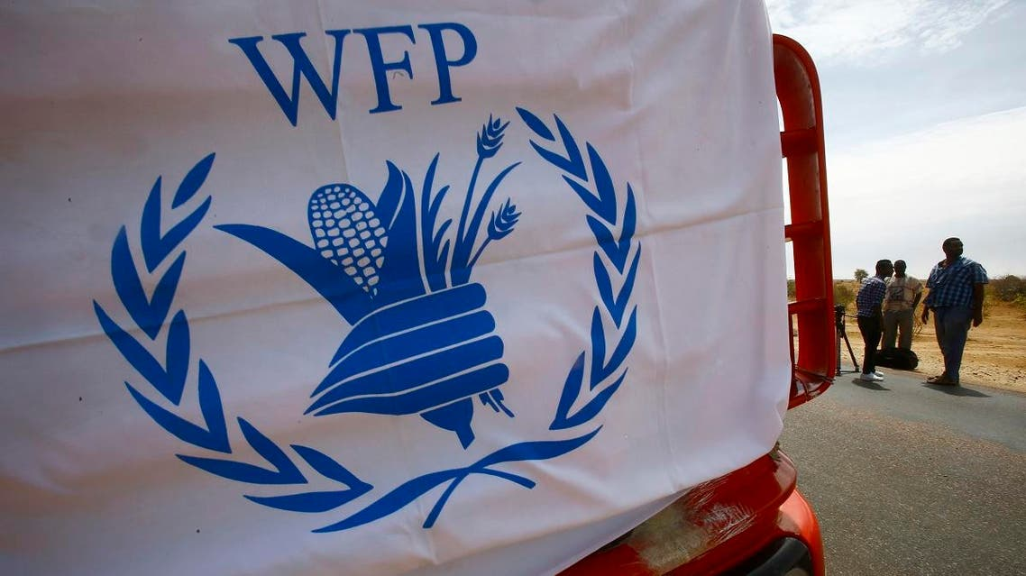 A convoy of trucks carrying humanitarian assistance provided by the World Food Program (WFP) to Southern Sudanese refugees, drives in the North Kordofan state, on May 19, 2017. (AFP)
