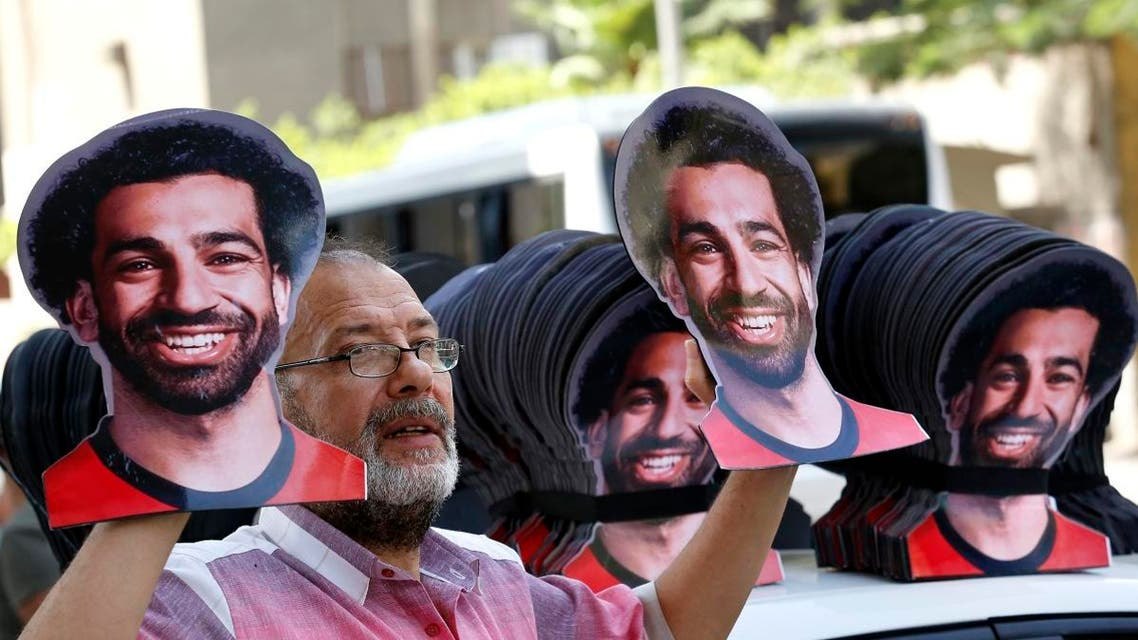 A vendor displays masks with pictures of Mohamed Salah ahead of the opening match between Egypt and Zimbabwe of the African Cup of Nations in Cairo, on June 21, 2019. (AP)