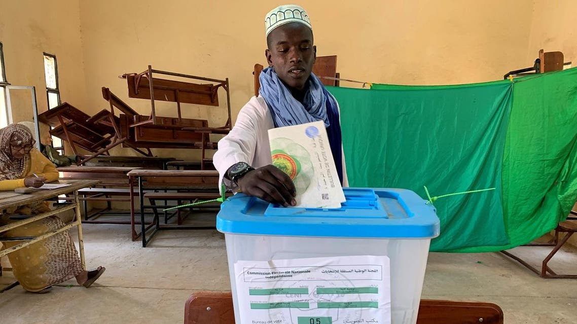 A man casts his vote at a polling station during presidential election in Nouakchott. (Reuters)