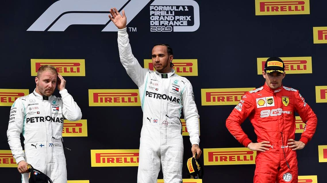 Winner Mercedes' British driver Hamilton (C) celebrates next to 2nd placed Mercedes' Finnish driver Bottas (L) and 3rd placed Ferrari's Monegasque driver Leclerc (R) after the F1 Grand Prix de France at the Circuit Paul Ricard in Le Castellet, southern France. (AFP)