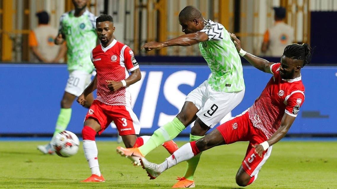 Nigeria's Odion Ighalo in action with Burundi's Elvis Kamsoba and Gael Bigirimana. (Reuters)