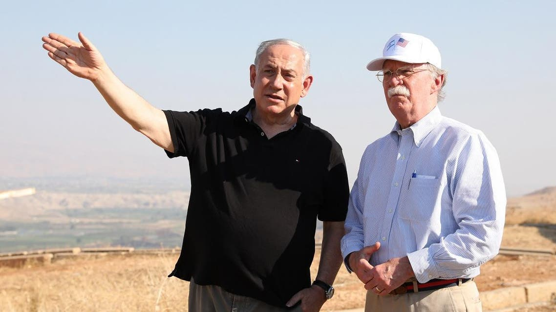 Israeli Prime Minister Benjamin Netanyahu and US National Security Advisor John Bolton (R) visit an old army outpost overlooking the Jordan Valley between the Israeli city of Beit Shean and the West Bank city of Jericho, on June 23, 2019. (AFP)