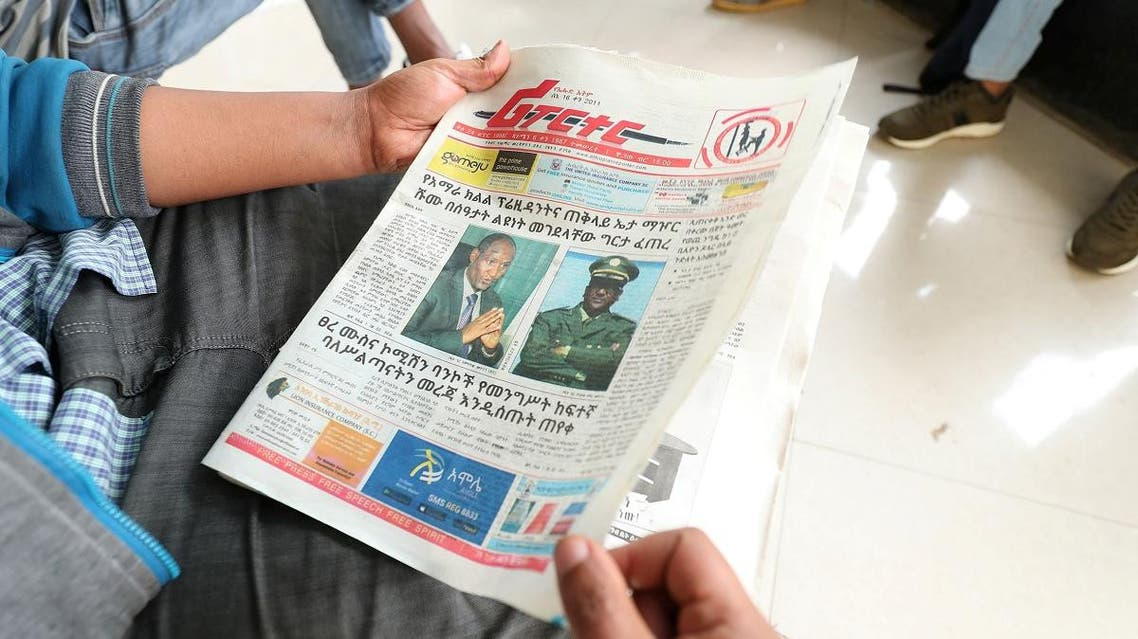 An Ethiopian man reads a newspaper on a street in Addis Ababa. (Reuters)