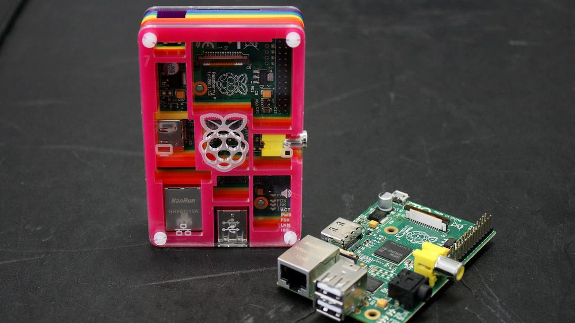 A picture shows two Raspberry Pi computers in London on July 8, 2013. The 25 USD (17 GBP, 19.50 euros) British microcomputer, the world's cheapest, has sold almost one-and-a-half million units in eighteen months, powering devices from coffee machines to aquatic drones across the world. AFP PHOTO / MONA BOSHNAQ