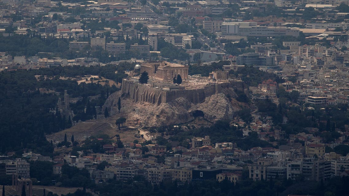FILE PHOTO: The Parthenon Temple is seen atop the Acropolis hill in Athens, Greece, June 20, 2019. REUTERS/Alkis Konstantinidis/File Photo