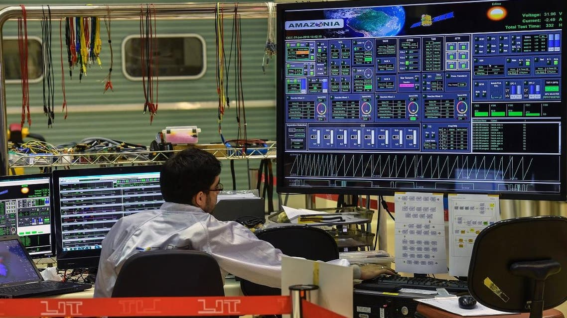 Brazilian researcher works on the AMAZONIA-1 satellite at the National Institute for Space Research (INPE) headquarters, in Sao Jose dos Campos, some 90 km north of Sao Paulo, Brazil, on December 5, 2018. (AFP)