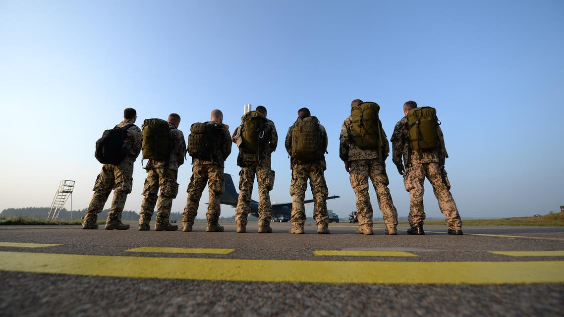 Soldiers stand in front of a Transall aircraft at the NATO airport in Hohn, northern Germany, on September 19, 2014. (AFP)