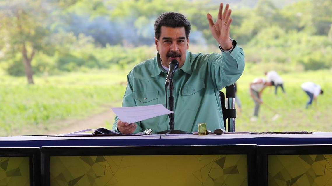 Venezuela's President Nicolas Maduro gestures while he speaks during a meeting with representatives of the agricultural sector in La Victoria. (Reuters)