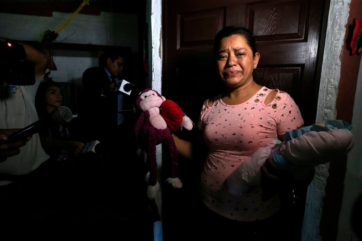 Rosa Ramirez sobs as she shows journalists toys that belonged to her nearly 2-year-old granddaughter Valeria in her home in San Martin, El Salvador. (AP)