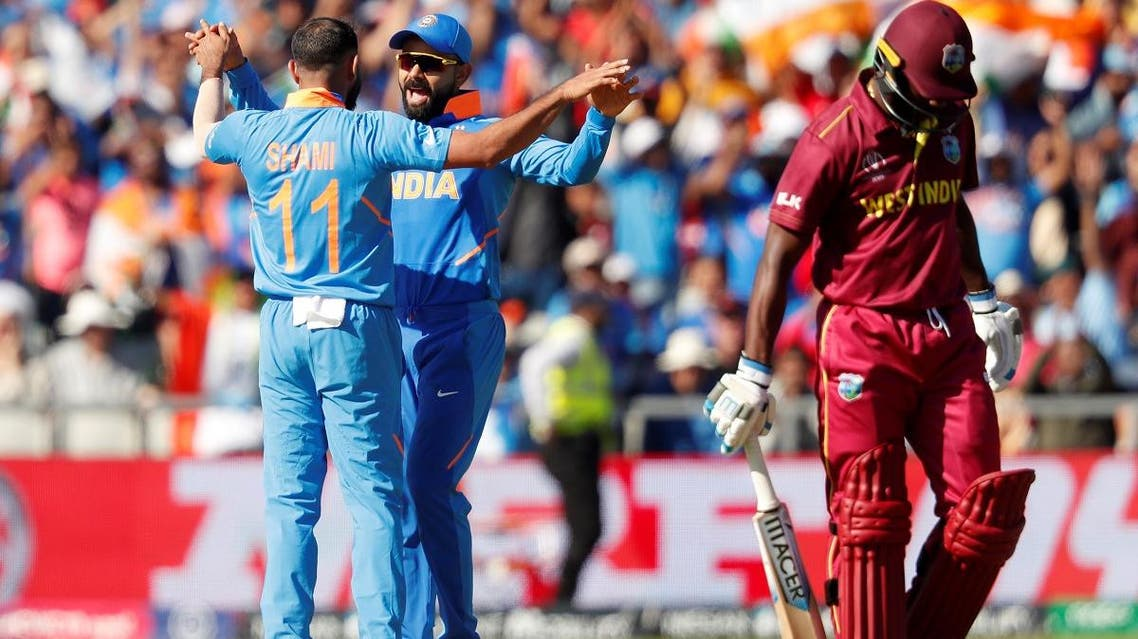 India's Mohammed Shami celebrates with Virat Kohli after taking the wicket of West Indies' Shimron Hetmyer in the ICC Cricket World Cup match at Old Trafford, Manchester, Britain, on June 27, 2019. (Reuters)