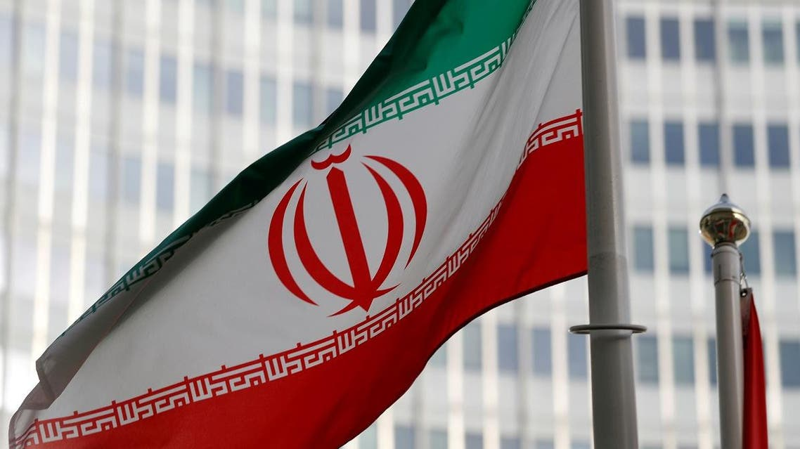 The Iranian flag flutters in front the International Atomic Energy Agency headquarters in Vienna, Austria. Reuters)