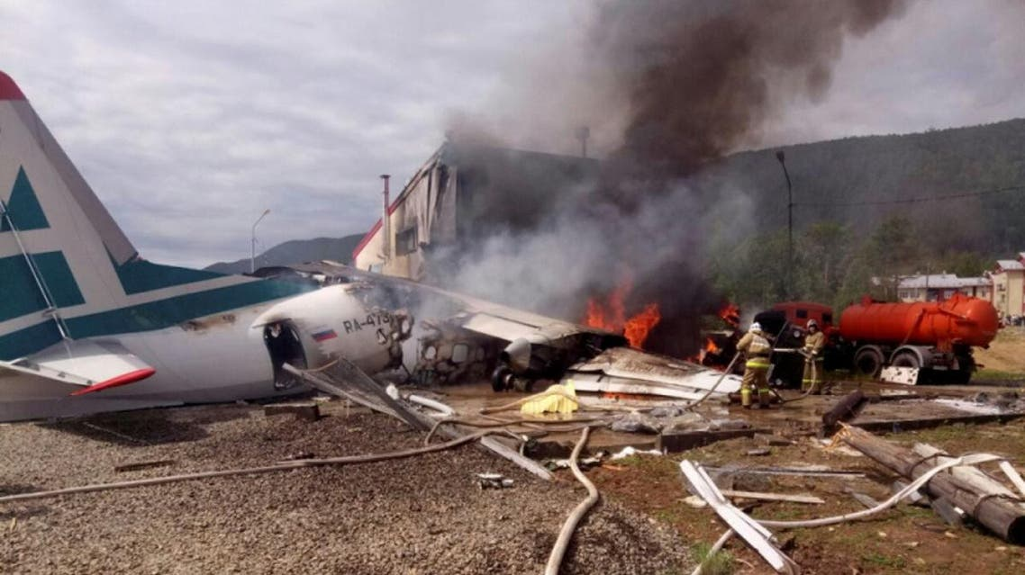 An Antonov An-24 passenger plane is seen on fire after an emergency landing in the town of Nizhneangarsk, Russia June 27, 2019. (Reuters)