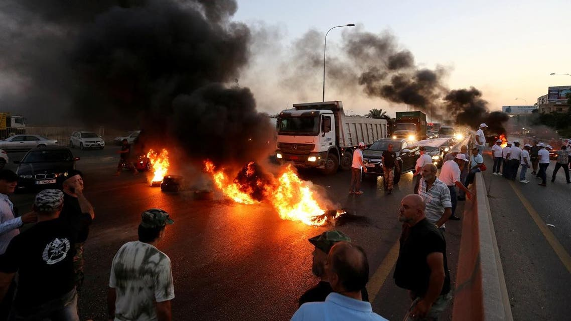 Lebanese army veterans burn tires during a protest over a state budget that includes a provision taxing their pensions, in Naameh, south of Beirut, Lebanon June 27, 2019. (Reuters)