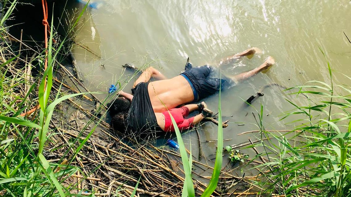 The bodies of Salvadoran migrant Oscar Alberto Martínez Ramírez and his nearly 2-year-old daughter Valeria lie on the bank of the Rio Grande in Matamoros, Mexico. (AP)