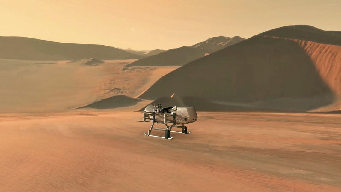 This NASA artist's illustration released on June 27, 2019, shows NASA's Dragonfly rotorcraft-lander approaching a site on Saturn's exotic moon, Titan. (AFP