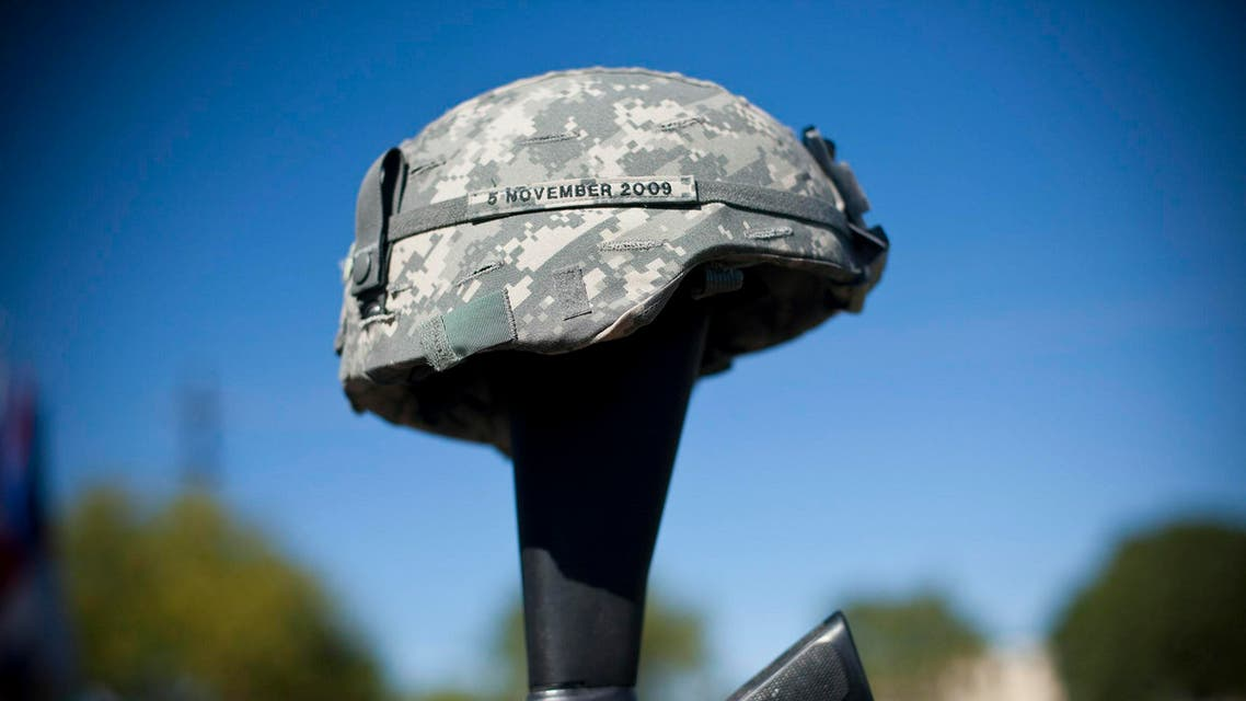 The soldiers memorial reads the date November 5, 2009 at a remembrance service recognizing the 13 victims killed in the Ft. Hood attacks on the one year anniversary in Killeen, Texas on November 5, 2010. (AFP)