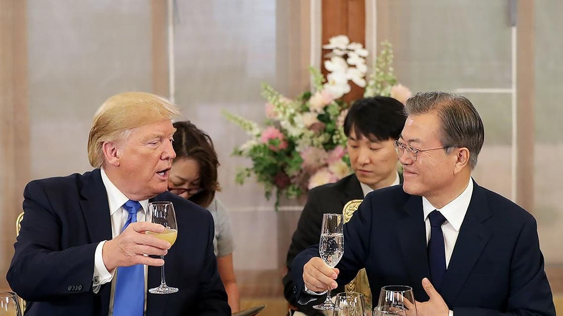 US President Donald Trump and South Korean President Moon Jae-in gesture at the presidential Blue House in Seoul. (AFP)