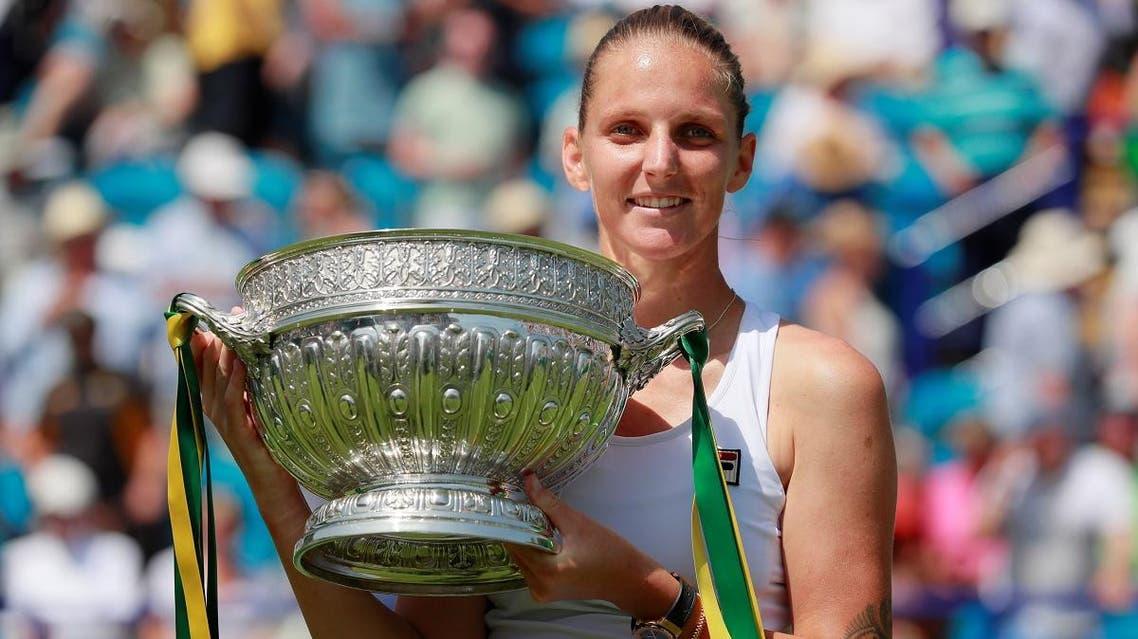 Karolina Pliskova celebrates with the trophy after winning the final against Germany's Angelique Kerber. (Reuters)