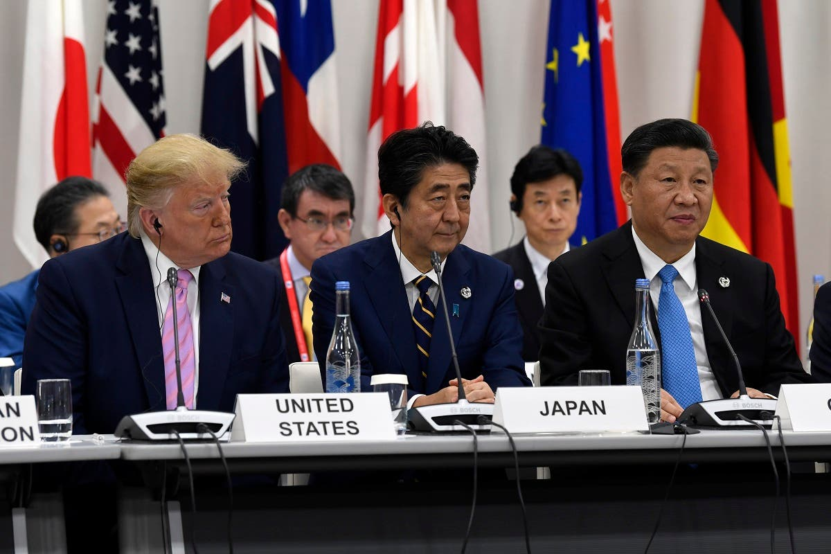 Chinese President Xi Jinping (right)speaks at the G-20 summit event on the Digital Economy in Osaka, Japan, on June 28, 2019. President Donald Trump and Japanese Prime Minister Shinzo Abe listen. (AP)