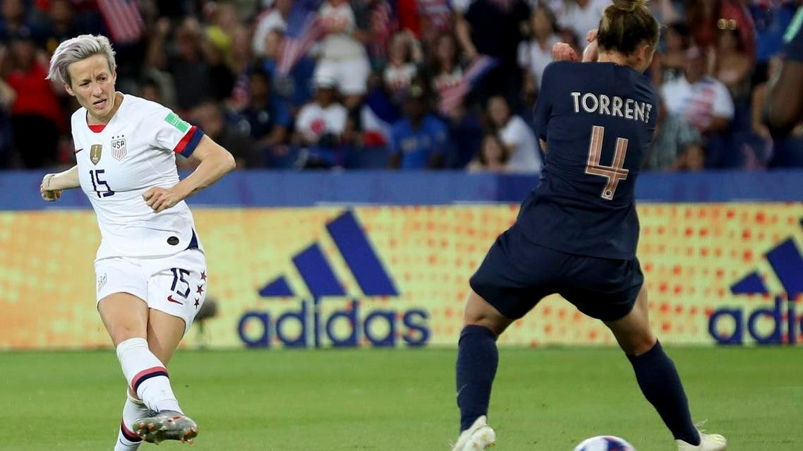Megan Rapinoe  (left), on her way to scoring her side's second goal during the Women's World Cup quarterfinal soccer match between France and the US at the Parc des Princes, in Paris, on  June 28, 2019. (AP)