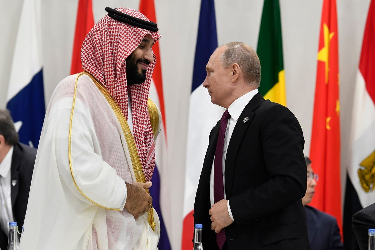 Saudi Arabia's Crown Prince Mohammed bin Salman and Russian President Vladimir Putin arrive for a working session of leaders at the G-20 summit in Osaka, Japan. (AP)