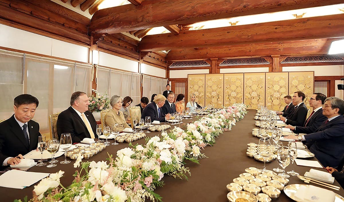 South Korea's President Moon Jae-in sought to appeal to Donald Trump's personal preferences on June 29, with a US steak dinner and a guest list including a star woman golfer. (AFP)