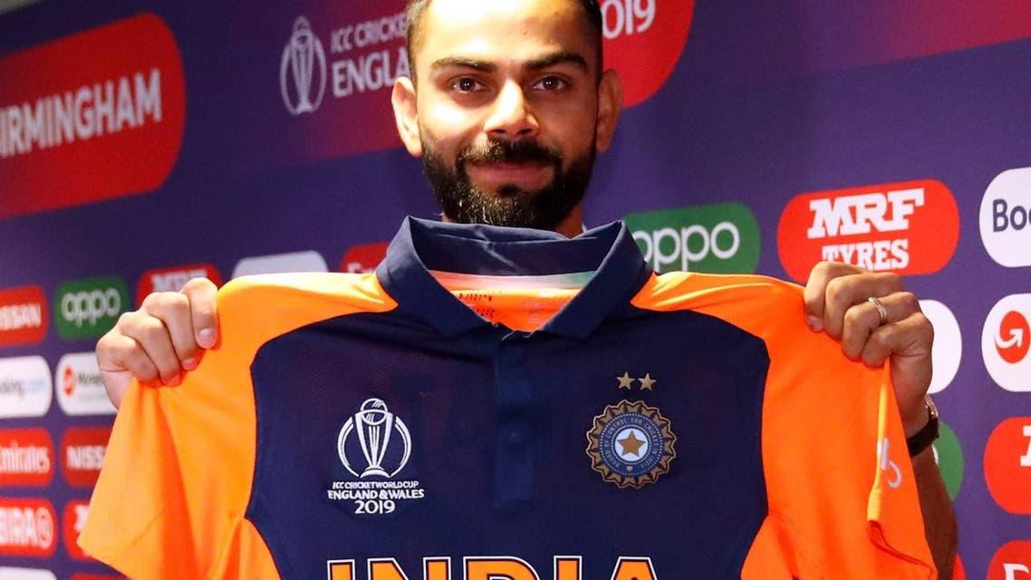India's Virat Kohli poses with his shirt during a press conference at Edgbaston, Birmingham, Britain, on June 29, 2019.  (Reuters)