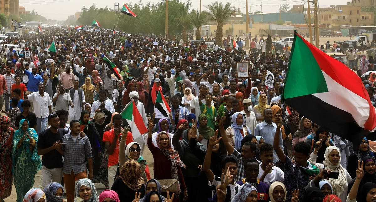 Tens of thousands of people march on the streets demanding the ruling military hand over to civilians. (Reuters)