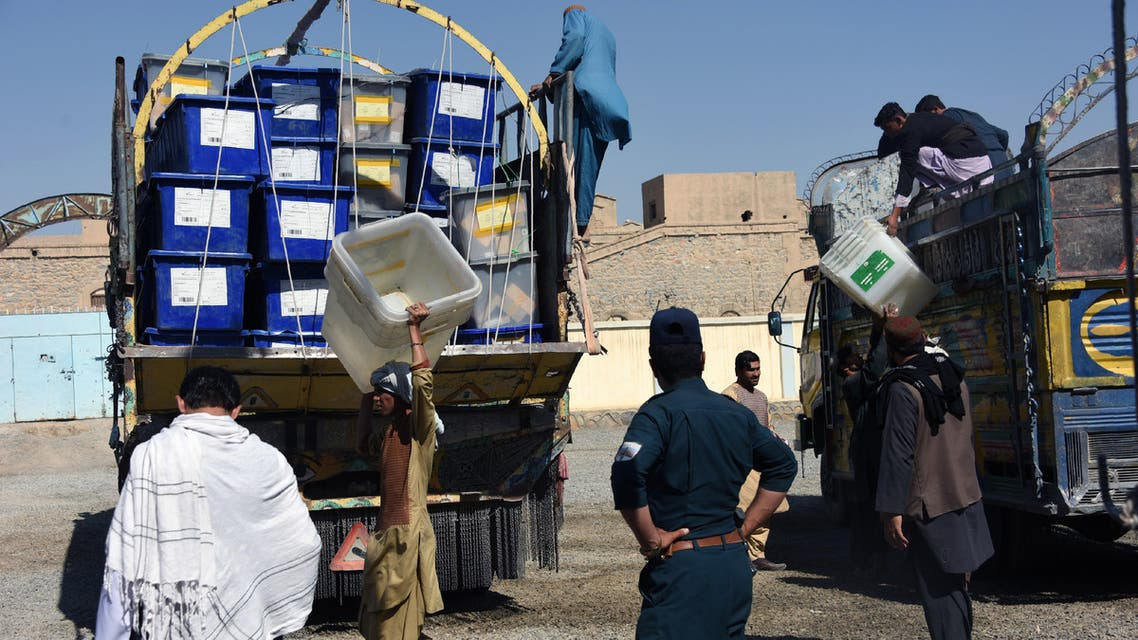 Afghan employees of the Independent Election Commission (IEC) unload ballot boxes from a truck at a polling centre ahead of legislative election in Kandahar province on October 26, 2018. Afghans will risk their lives to vote in elections in southern Afghanistan on October 27, after the Taliban-claimed killing of a powerful police chief delayed the ballot by a week.