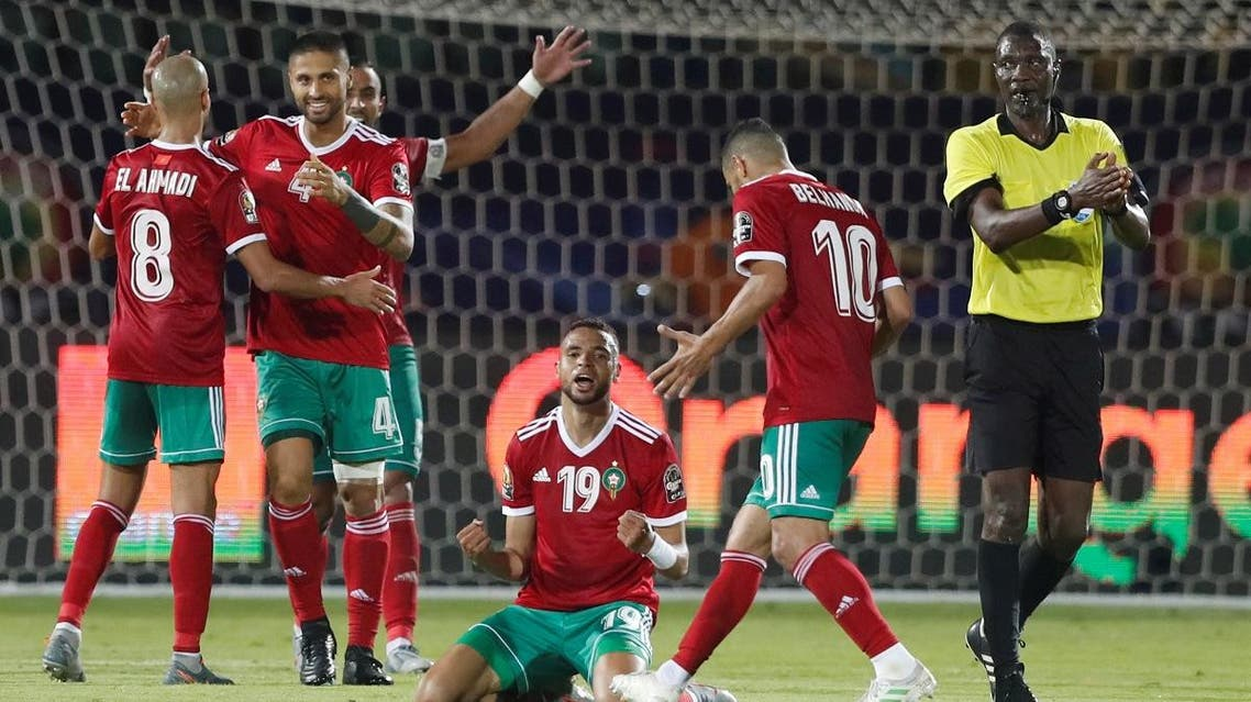 Morocco's Youssef En-Nesyri celebrates with team mates after the match. (Reuters)