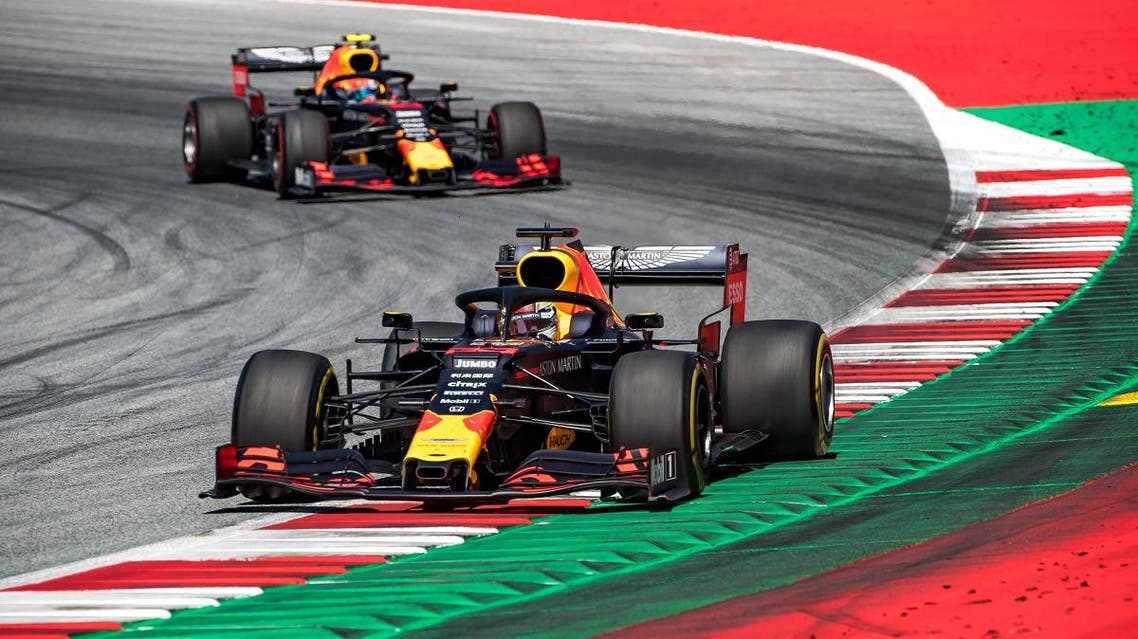 Red Bull's Dutch driver Max Verstappen steers his car in front of Red Bull's French driver Pierre Gasly during the Austrian Formula One Grand Prix in Spielberg on June 30, 2019. (AFP)