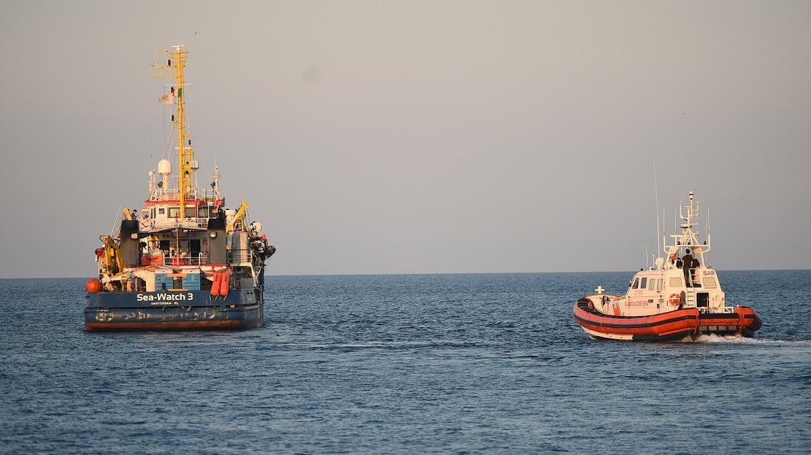 the Sea-Watch 3 rescue ship leaves after migrants disembark in Lampedusa. (AP)