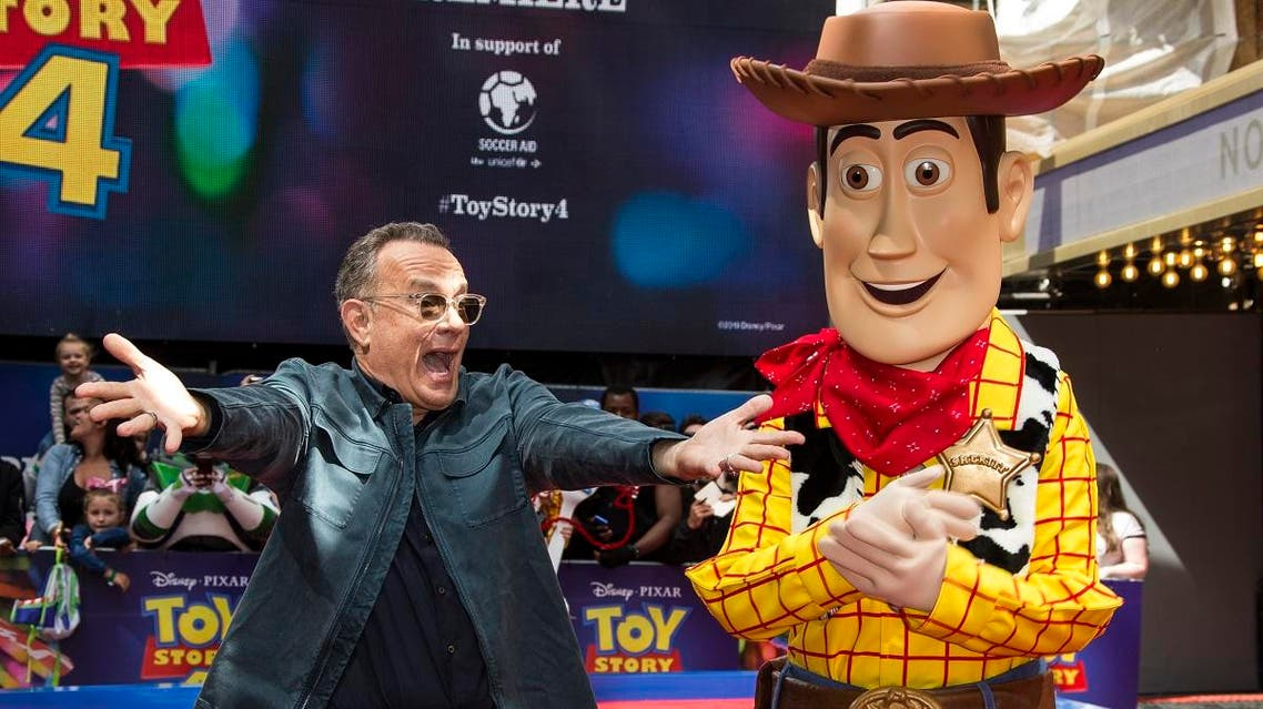 Actor Tom Hanks poses for photographers with his Toy Story character 'Woody', upon arrival at the screening for 'Toy Story 4' in London, Sunday, June 16, 2019. (AP)