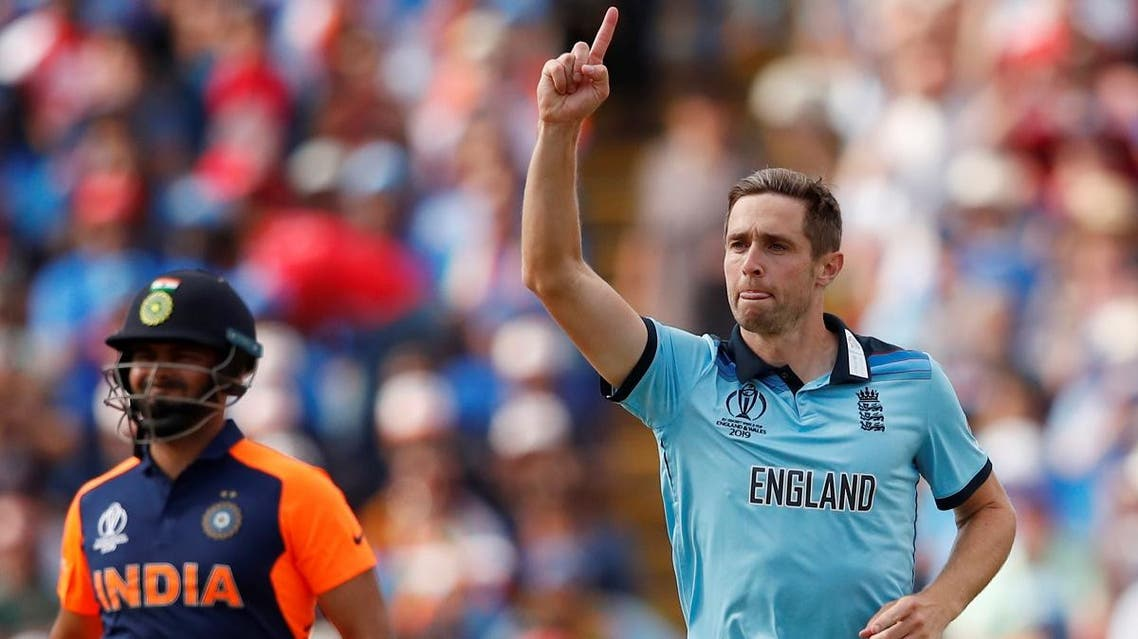 England's Chris Woakes celebrates after taking the wicket of India's Rohit Sharma during the ICC Cricket World Cup group match at Edgbaston, Birmingham, Britain, on June 30, 2019. (Reuters)