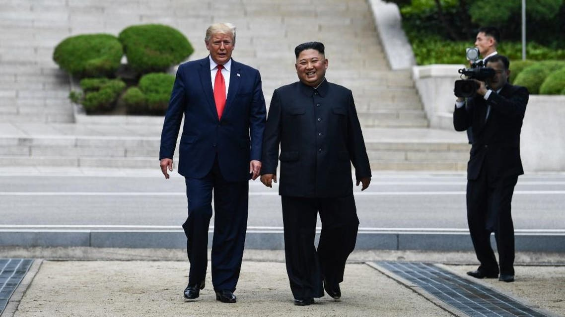 US President Donald Trump meets with North Korean leader Kim Jong Un at the DMZ separating the two Koreas, in Panmunjom. (AFP)