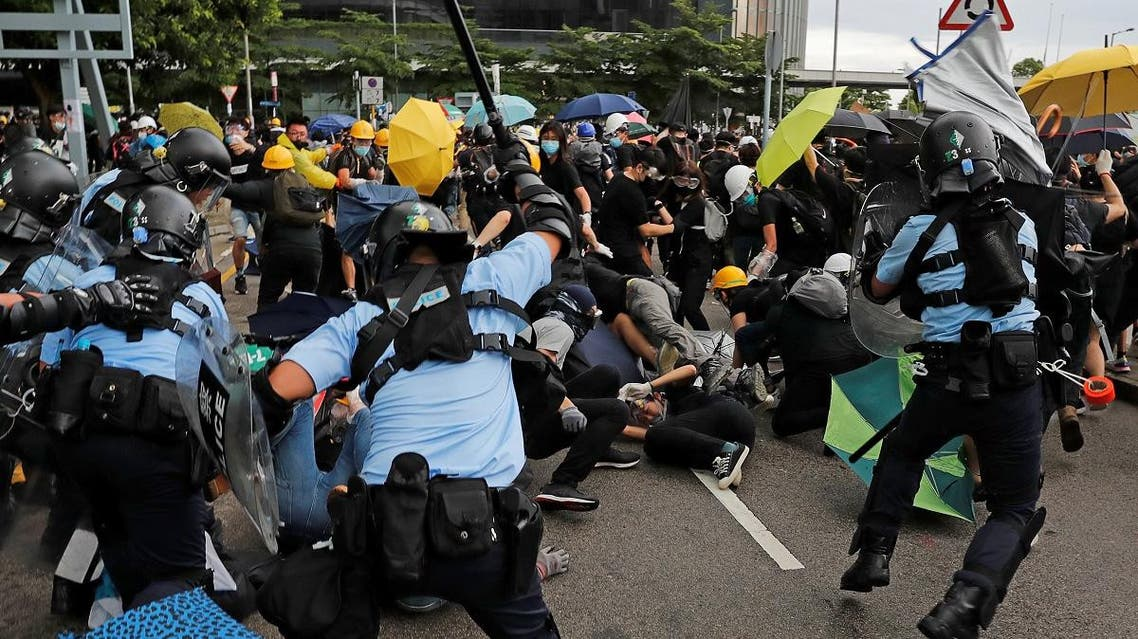 Riot police try to disperse protesters on the anniversary of Hong Kong's handover to China in Hong Kong. (Reuters)