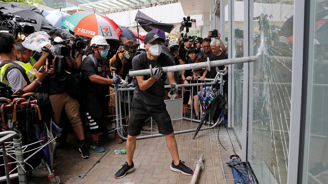 Protesters try to break into the Legislative Council building where riot police are seen, during the anniversary of Hong Kong's handover to China in Hong Kong. (Reuters)