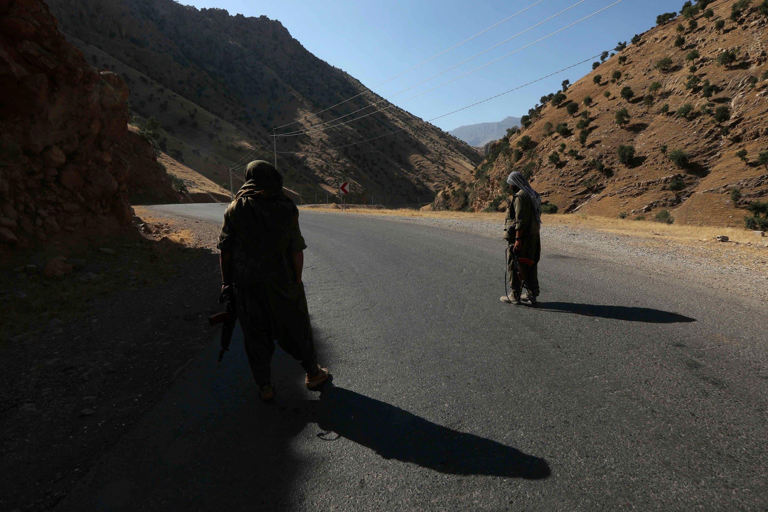 A member of the Kurdistan Workers' Party (PKK) on the road in Iraqi Kurdistan.