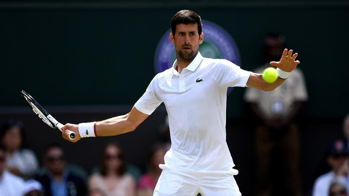 Serbia's Novak Djokovic in action during his first round match against Germany's Philipp Kohlschreiber. (Reuters)