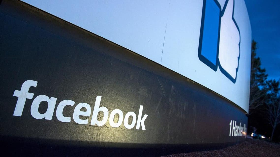 A lit sign is seen at the entrance to Facebook's corporate headquarters location in Menlo Park, California. (AFP)