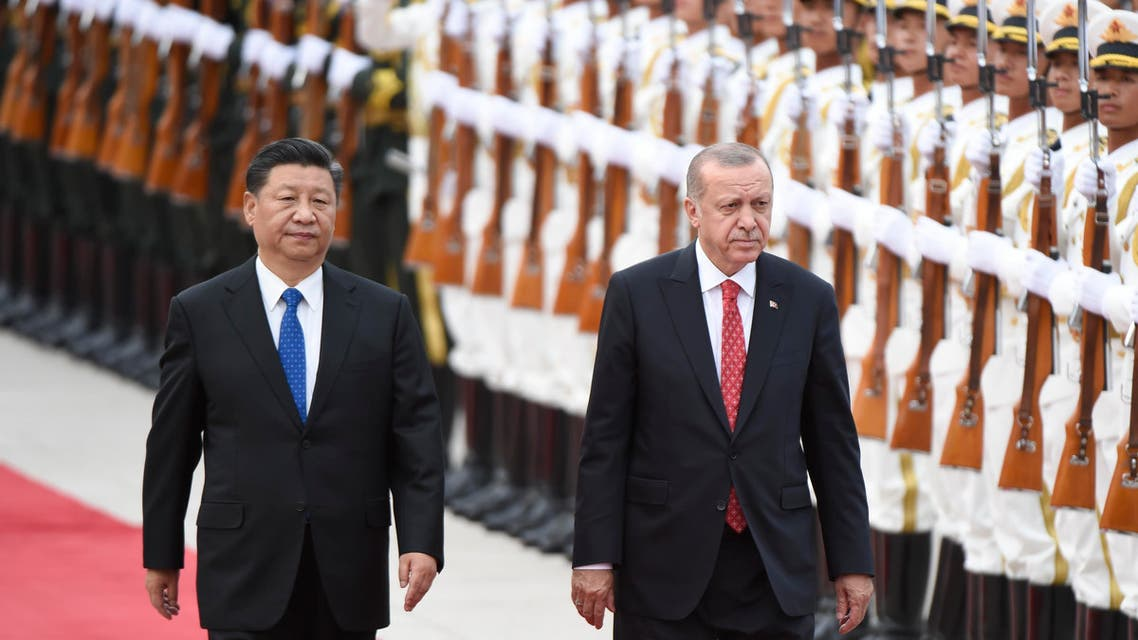Turkish President Recep Tayyip Erdogan (R) and Chinese President Xi Jinping (L) inspect Chinese honour guards during a welcome ceremony outside the Great Hall of the People in Beijing on July 2, 2019.(AFP)