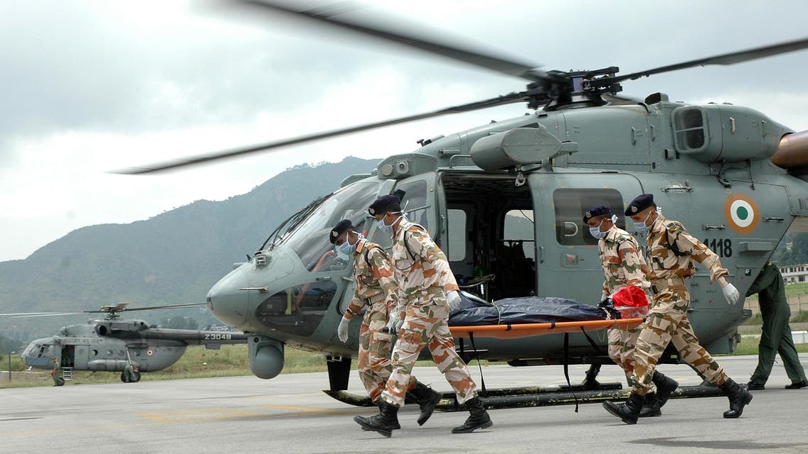 Indo-Tibetan Border Police (ITBP) personnel carry the body of one of the seven climbers killed in an avalanche near India's second highest mountain in May, in Pithoragarh town, northern Himalayan state of Uttarakhand (Reuters)