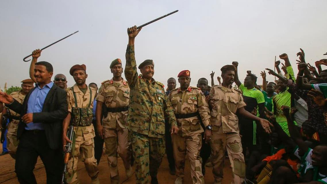 General Abdel Fattah al-Burhan, the head of Sudan's ruling military council, greets his supporters in Khartoum's twin city of Omdurman. afp