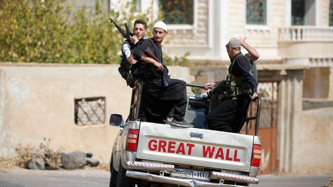 In this Thursday, Oct. 4, 2018, photo, young Druze armed men, patrol the village of Rami in the southern province of Sweida, Syria. AP