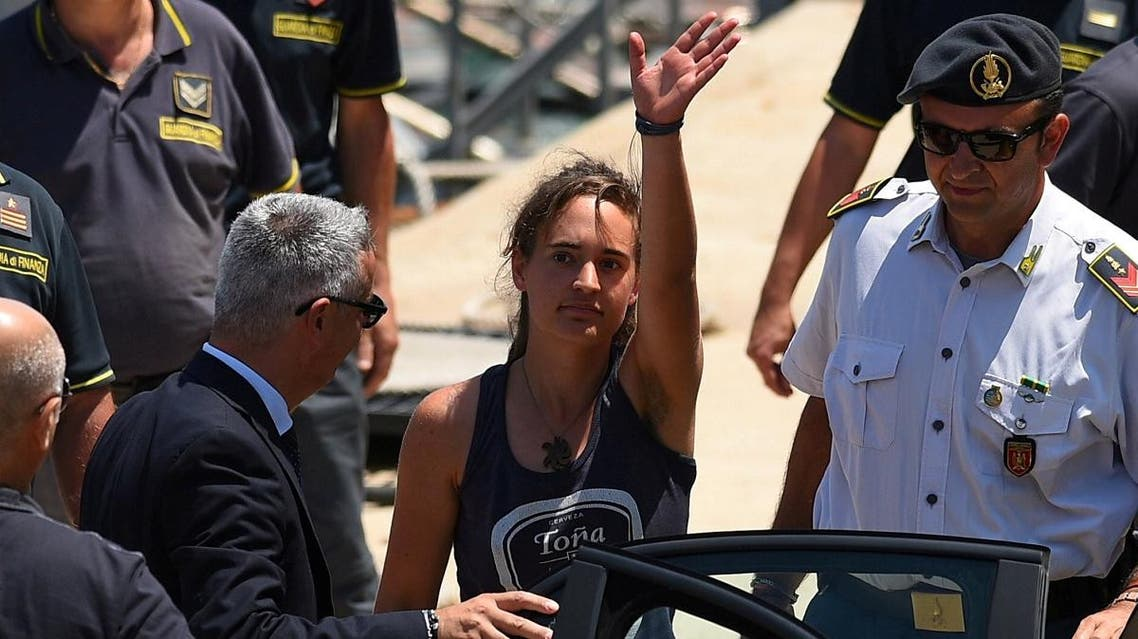 Sea-Watch 3 captain Carola Rackete is escorted off the ship by police and taken away for questioning, in Lampedusa. (Reuters)